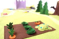 felt garden on a playmat - those carrot tops just beg to be pulled!