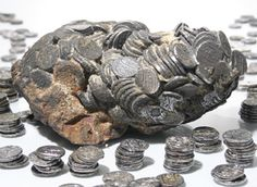 The Taj Mahal sunken treasure, approximately 800 silver coins minted in 1702, can now be seen at Cannon Beach Treasure Company.