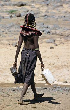 Africa   Pokot woman fetching water. North of Baringo, Kenya   ©Olivier Darmon