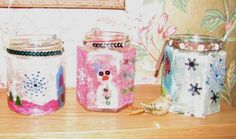 Christmas Kids Craft Snowy Lanterns/ Tealight Holders. Christmas lanterns  Cover glass jam jars with tissue paper designs (use a wash of PVA glue) and add glitter, sequins and other little gems.  Twist wire round the top of the jar to make a handle and op in a tea light so your lanterns can twinkle away on a dark winter's night.