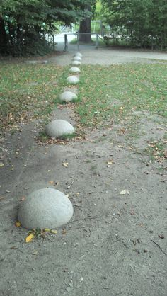 Domed stepping stones to mark a boundary, but also a balancing activity.