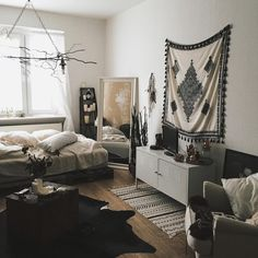 """Needed a change.. so living room is also bedroom from now on and the new wall hanging I got, is actually from ZARA ( its a scarf )#interior"""