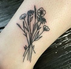 Wild flowers tattoo #flower #tattoo #girls #women #bud #petals #leaves…