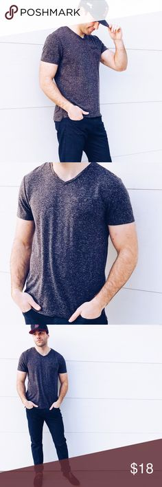 """Men's Grey Kenneth Cole Reaction Tee ✔️Men's relaxed, dark grey super soft casual v-neck tee. Kenneth Cole Brand. Functional button up pocket. NEW WITHOUT TAGS   ✔️Size M. 88% polyester, 12% linen.   ✔️Model Stats:      -5'9     -Shirts: S/M     -Pants: 32""""  ⚫️Bundle to save 5% on 3+ Items  ▫️Add to Bundle"""" to add more items in my closet or """"Buy"""" to checkout here with your size. Kenneth Cole Reaction Shirts Tees - Short Sleeve"""