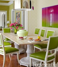 """Green is easy to work with if you use different shades,"" Pat Healing says. With that in mind, she upholstered the breakfast room's chairs in Sonia's Place Safari vinyl. The shade works with, but doesn't match, the seating in the family room of this New York home. The wallpaper is Moroccan in Green by Phillip Jeffries. Green Courtesan urn is by HB home.   - HouseBeautiful.com"