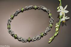 Peridot small Celtic knot silver bracelet by SilverPuha on Etsy