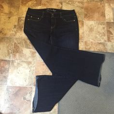 AE Stretch Artist Jeans Like new. Worn once. American Eagle Stretch Artist Bootcut Jeans. Dark Wash. Size 14 Regular American Eagle Outfitters Jeans Boot Cut