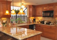 Oak cabinets with Saratoga style doors and drawers. Golden Crystal Granite with full height grantie splash. Kohler Faucet and Minka Lavery Lights.