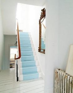 it would be awesome to do our basement stairs like this! really dresses up wooden stairs