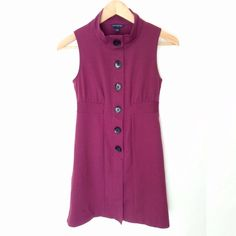 Banana Republic Sleeveless Dress This dress is in excellent shape and would look great with some tights and boots.  The color is cranberry and hits right above the knee. Banana Republic Dresses Midi