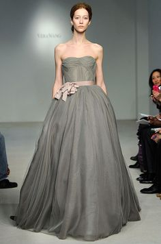 This flowing gray Vera Wang ball gown is complimented with a blush-  hued ribbon belt.