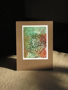 Love the mottled background on this otherwise clean and simple Winter hydrangea card by franziska2010, via Flickr.