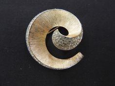 Vintage Goldtone Clear Rhinestone Satin Finish Swirl Brooch Pin Trifari Designer