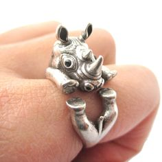 - Details - Sizing - Shipping For animal lovers and animal enthusiasts, this animal ring is made to look like a realistic rhinoceros is wrapped around your finger in silver! Unique & Cute! Store FAQ |