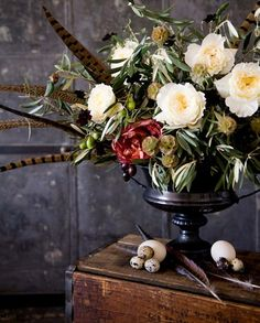 Beautiful floral arrangement - love the feathers!