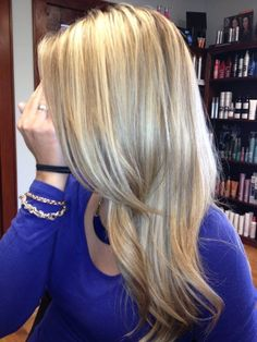 Dimensional highlights and lowlights on our stylist Cici, she's being camera shy!  #haircolor #blonde #highlights #lowlights