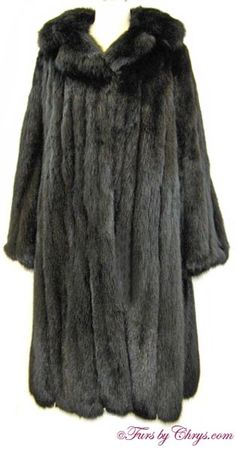 Black Sable Coat BS789; $6000 (reduced!); Excellent Condition; Size estimate: Misses 6 - 10. This is a stunning genuine dyed black sable fur coat, which looks as if it has been very rarely worn. This gorgeous sable coat features a large notched collar and straight sleeves. When you desire the elegance and sophistication that only sable can provide, look no further than this luxurious black sable coat.  fursbychrys.com