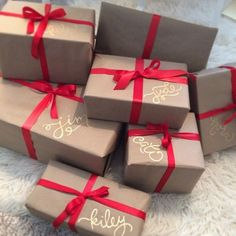 This simple idea makes gift wrapping easy and how sweet is that? :) Brown paper, red ribbon (or color of choice) with Gold paint pen to write the names. <3