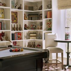 """Nicely """"dressed"""" shelves with collections.  Doesn't look THAT cluttered + there are still SOME books.  So that will make DDG happy (I want her to get rid of all books that aren't hardback + attractively old! :)"""