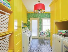 What do you get when you cross Lilly Pulitzer with a love of modern design? For homeowner Perrie Tomlin, it meant an equally cool and colorful kitchen and laundry redo—and fortunately, a designer who could interpret her vision. Yellow Laundry Rooms, Laundry Room Colors, Laundry Room Design, Laundry Area, Laundry Room Shelves, Laundry Room Cabinets, Landry Room, Yellow Cabinets, Yellow Walls