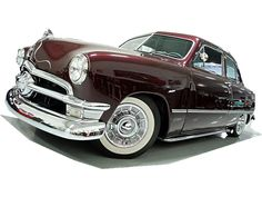 1950 Ford Custom sedan.  My FIRST car was similar except it had a cream colored top with a polynesian bronze color below the windows....added fender  skirts, mirrows and a swan to lead the way.  Awesome car before it met a ditch during a snow storm!