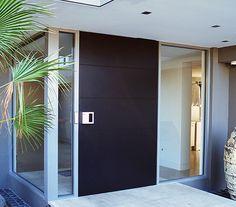 Timber pivot entrance door makes a bold design statement.