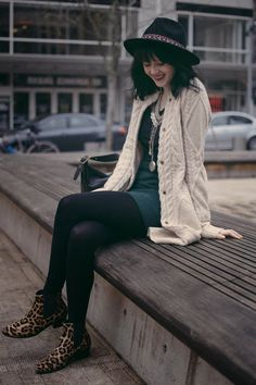 cableknit cardigan with green and leopard print boots -- and hat