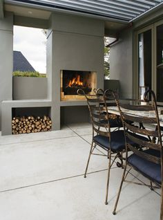 Fireplace!! Very cool idea to create an outdoor room if you have a large space outside