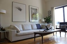 Scale of art, couch, beautiful chair, uncluttered coffee table.