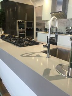 PHOTO 7: This photo was taken in the world of style showroom. I loved the stone bench top. The colour works well in this kitchen and it's quite a beautiful piece.