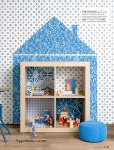 With contact paper and a bookshelf, you can make a nice doll house for your little girl.