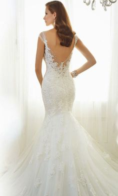 Gorgeous mermaid wedding dress by Sophia Tolli - totally elegant lace. See more: http://www.weddingforward.com/24-most-gorgeous-wedding-dresses/ #weddingdresses #weddingdress