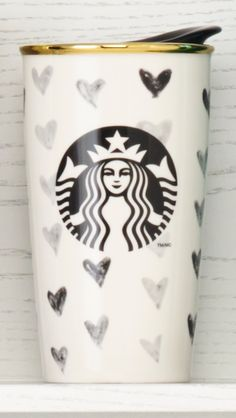 A double-walled ceramic mug with a black heart design. #DotCollection #Starbucks