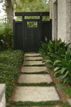 houzz.com - i'm wanting a path on my side yard now, to go with that fence and gate to hide the garbage cans. this gate/fence is so pretty and the large pavers with grass look doable!