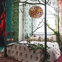 ⋴⍕ Boho Decor Bliss ⍕⋼ bright gypsy color hippie bohemian mixed pattern home decorating ideas - Woodland bedroom with iron four-poster bed.