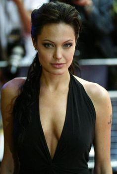 """For the red carpet premiere of """"Lara Croft Tomb Raider: The Cradle of Life,"""" Jolie went with a sultry smoky eye, natural lip, and loose, wavy ponytail."""