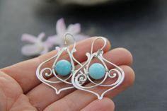 Elegant sterling silver and aqua quartz dangle earrings
