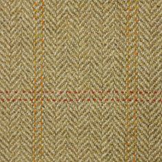 Aberfeldy Estate Tweed Fabric A hardwearing pure wool tweed fabric with a subtle stitched check of coral and orange woven on a caramel herringbone ground.