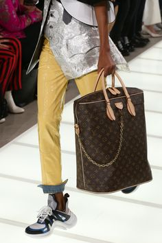 Details of a monogram bag and sneakers from the Louis Vuitton Spring-Summer 2018 Show by Nicolas Ghesquiere. Watch the show now at louisvuitton.com.