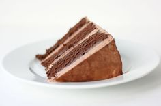 quintessential chocolate cake; cake is rich and moist and fudgy but also light and delicate; is a double chocolate butter and sour cream cake with a cocoa whipped buttercream frosting