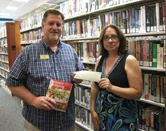 Rotary Club of Dawson County's $1,000 donation to the Dawson County Library.