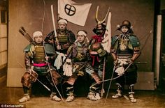Circa, 19th century. A group of samurai warriors in their traditional armour and brandishing bow & arrows and swords.