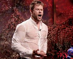 GIF: Chris Hemsworth on The Tonight show getting sprayed with water by Jimmy Fallon.