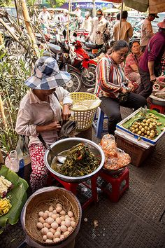 Selling goods at the Central Market - Phsar Thmei - in Phnom Penh, Cambodia.