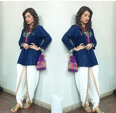 "White Tulip Pants and Blue Shirt Outfit in Ayeza Khan with Traditional Style Jewellery and Pouch on the set of ""Mohabbat Tumse Nafrat Hai"". Indian Designer Outfits, Indian Outfits, Designer Dresses, Blue Shirt Outfits, Tulip Pants, Fashion Pants, Fashion Outfits, Pakistani Dresses Casual, Kurta Designs"