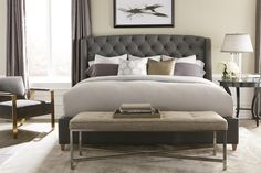 Bold tufting and nailhead trim come together to give you a stylish fully upholstered bed including the footboard and side rails. The headboard has winged sides for a dramatic look. This bed is also available in 54 inch height.