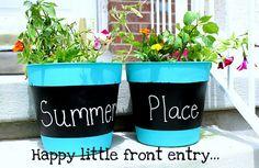 Cute Chalkboard paint & aqua planters.  So summery!