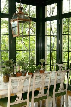 A 16-Color Spring-Inspired Whole-House Paint Palette | fabulous hunter Green Sun Room dining area by Windsor Smith. I adore everything about this space and its furnishings! LOVE the Gustavian dining chairs.