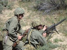 A World War II Pacific reenactment event in Southern California. Operating a M1919 .30 caliber Browning machine gun.
