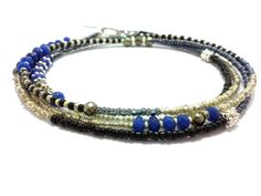 Hey, I found this really awesome Etsy listing at https://www.etsy.com/listing/202997556/multi-strand-seed-bead-bracelet-wrap